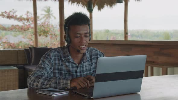 Young Asian Man Working in Call Service