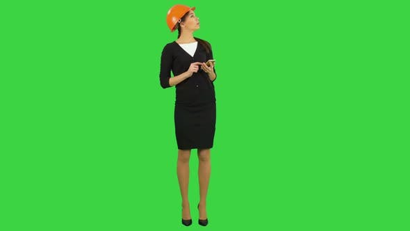 Thumbnail for Female Engineer in Helmet Using Phone To Take Photo of Construction on a Green Screen, Chroma Key.