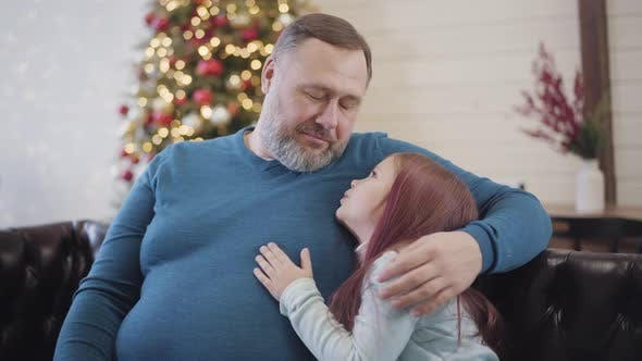 Thumbnail for Portrait of Happy Mid-adult Father Hugging Little Cute Daughter and Talking. Cheerful Caucasian Man