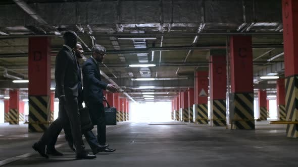 Thumbnail for Businessmen in Suits Walking in Underground Garage