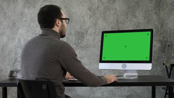 Thumbnail for Bearded young businessman woking on computer, Green Screen