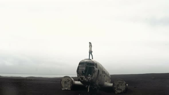 Thumbnail for Young Woman Standing on the Top of Breaker DC3 Plane in Iceland, Female Exploring Deserted Black