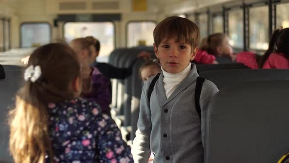 Thumbnail for Cute Schoolboy Talking with Girl Classmate in Bus