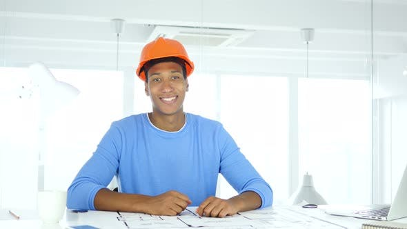 Thumbnail for Smiling Afro-American  Architectural Engineer Looking at Camera