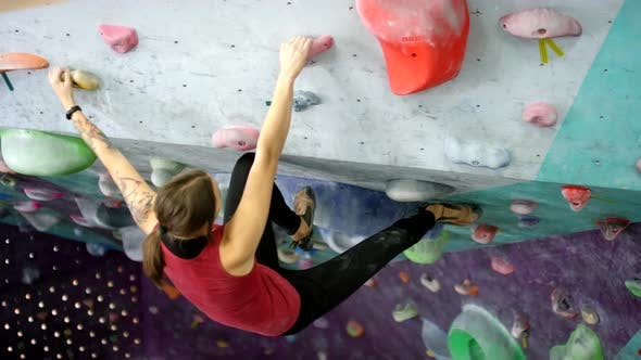 Thumbnail for Female Athlete Training on Indoor Climbing Wall with Overhang