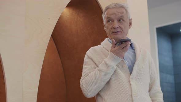Aged Caucasian Businessman Having Phone Talk in Office