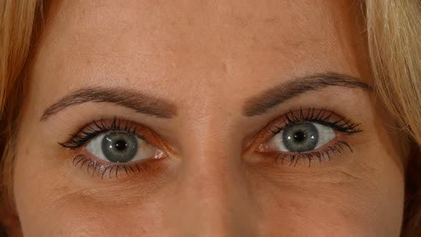 Thumbnail for Beautiful Blue Eyes of a Mature Woman Looking To the Camera