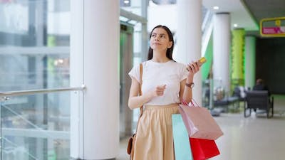 Woman Using Real Time Navigation Application to Find Store