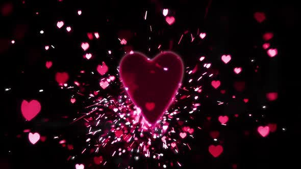 Thumbnail for Pink heart confetti and sparks flying against pink heart