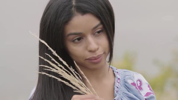 Thumbnail for Portrait of the Beautiful Young African American Girl Holding Ears of Wheat on the Field