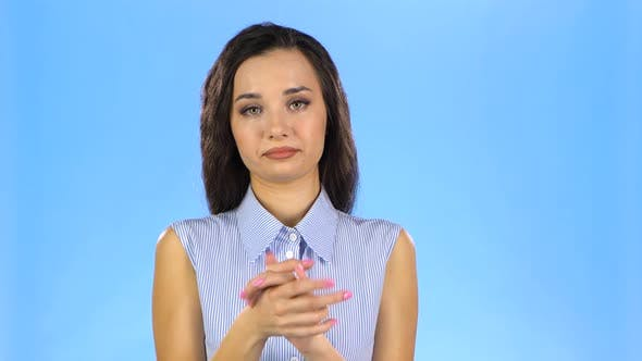 Pretty Young Woman Is Clapping Hands with Disappointment