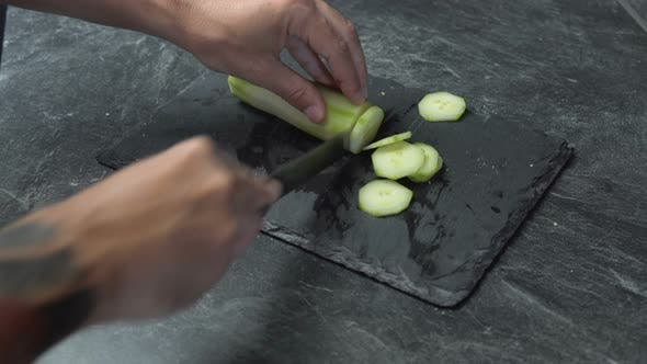 Thumbnail for Close Up on Male Hands Cutting Cucumber, Making Salad. Chef Cutting Vegetables.