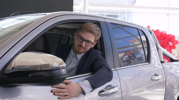 Thumbnail for Auto Business, Consumer Guy Relish New Car and Shows Keys Sitting in Salon and Peeking Through