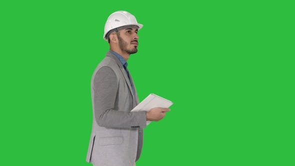 Cover Image for Architect walking with tablet and checking what is built