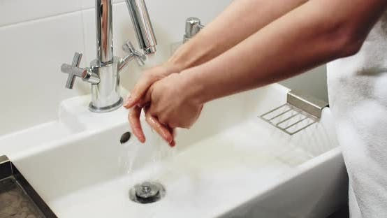 Thumbnail for Washing Hands in Washbasin