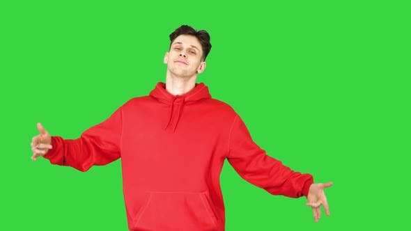 Thumbnail for Casual Man in Red Hoody Dancing on a Green Screen, Chroma Key.