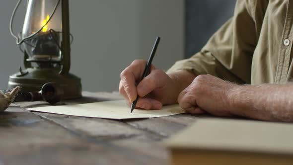 Thumbnail for Footage Compilation of Old-Fashioned Elderly Man Writing Letter