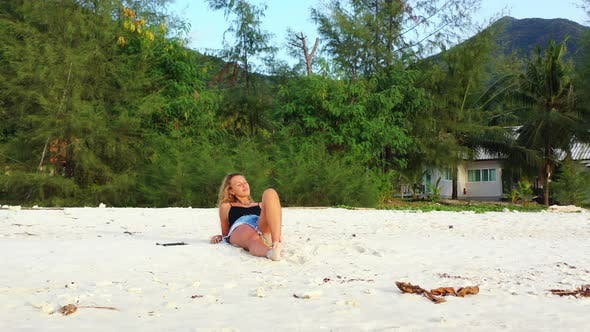 Thumbnail for Young happy ladies on vacation enjoying life at the beach on sunny blue and white sand background