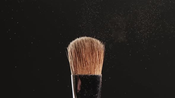 Thumbnail for Two Makeup Brushes Touch Each Other on Black Background and Small Particles of Cosmetics - Shadows