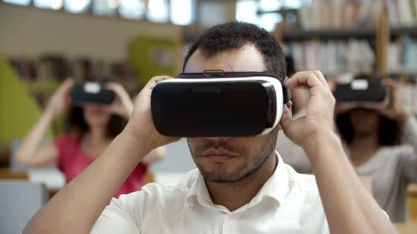 Thumbnail for Front View of Focused Guy Wearing VR Headset