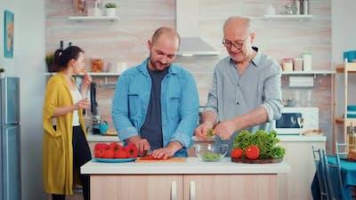 Grandfather and Son Preparing a Salad