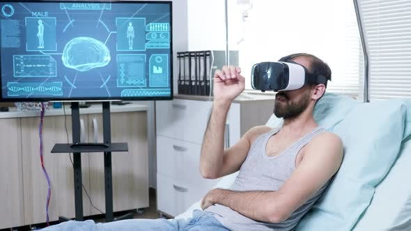 Thumbnail for Patient in a Neuroscience Centre Wearing Vr Goggle and Making Hand Gestures