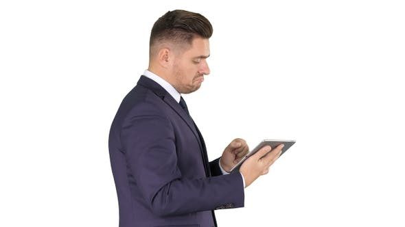 Thumbnail for Smart senior businessman using a technology tablet on white