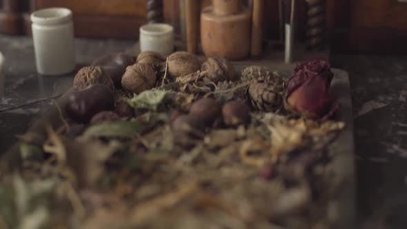 Thumbnail for Camera Moving Up Showing Dried Flowers, Nuts and Retro Style Test Tubes. Ancient Chemical