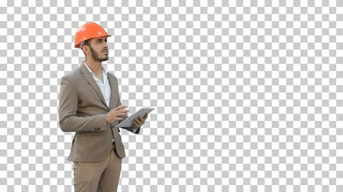 Engineer in safety helmet conducting inspection, Alpha Channel