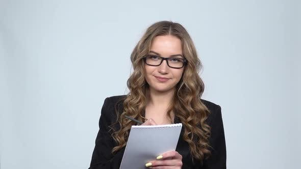 Thumbnail for Woman in Business Suit Writes in Notebook, Slow Motion