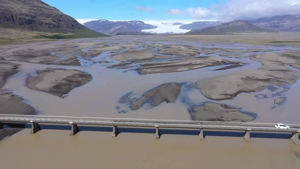Cover Image for Aerial View of A Car Crossing a Bridge Over a Glacial River