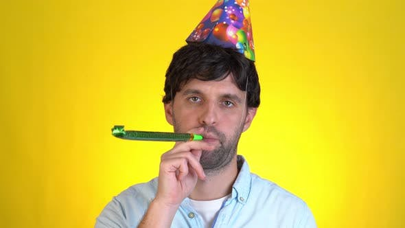 Thumbnail for Sad Upset Serious Man in Birthday Hat Basic in Pipe Celebrate Party Day Isolated on Yellow