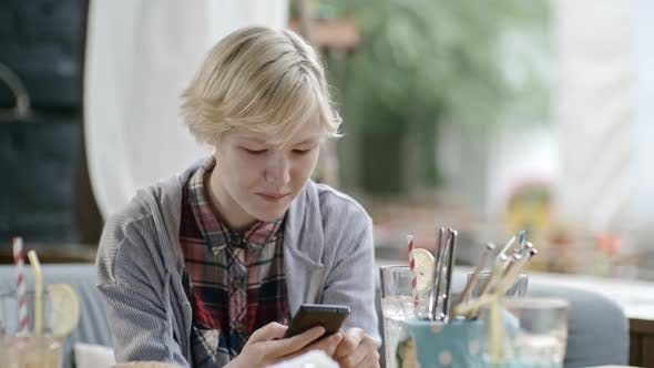 Thumbnail for Girl Texting on Phone at Lunch