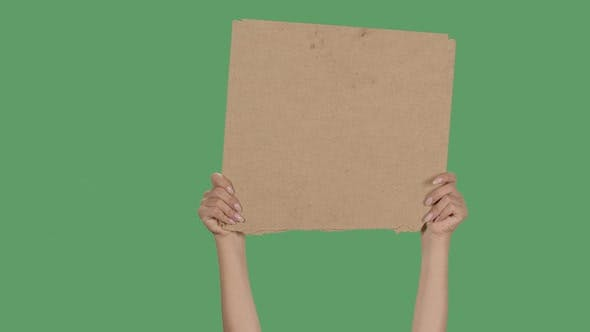 Thumbnail for Protest Banner Copy Space. Female Hands Are Holding Blank Cardboard. Advertising Platform. Isolated