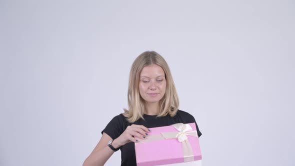 Thumbnail for Young Happy Blonde Woman Opening Gift Box and Looking Surprised