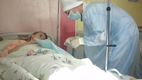 Thumbnail for Nurse Preparing Female Patient Arm To Put IV Tube