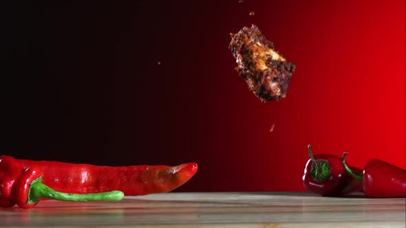 Smoked chicken wings falling and bouncing in ultra slow motion 1500fps - CHICKEN WINGS PHANTOM