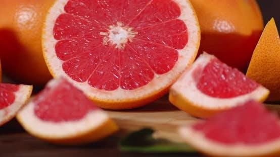 Slices of Ripe Juicy Grapefruit Slowly Rotate.