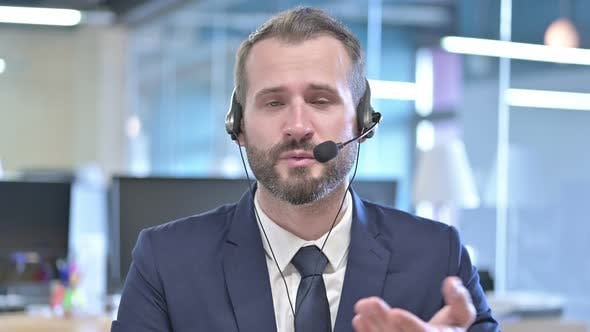 Thumbnail for Portrait of Young Businessman Talking on Headset