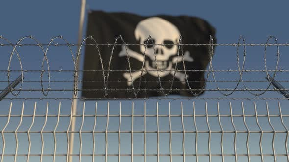 Thumbnail for Barbed Wire Against Defocused Waving Jolly Roger Pirate Flag