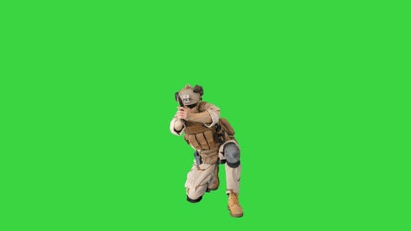 Thumbnail for Soldier Is Shooting Sitting on His Knee on a Green Screen, Chroma Key.