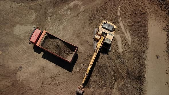 Thumbnail for Excavator Pours Sand Into the Truck