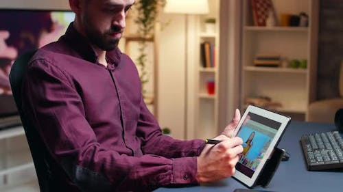 Art Director Retouching Photo on Tablet Computer