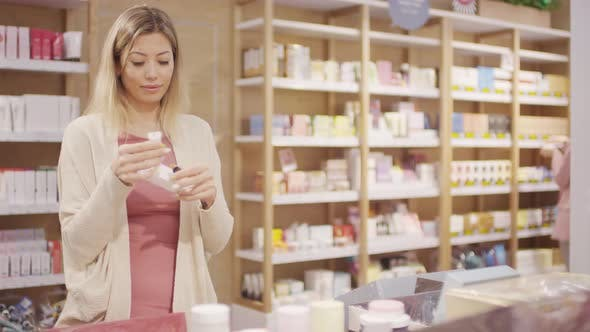 Thumbnail for Young Woman Trying Cream at Cosmetic Store