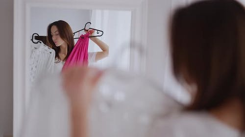 Woman Selecting Clothes in Morning