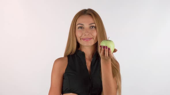 Thumbnail for Beautiful Healthy Woman Smiling, Holding Out Delicious Apple To the Camera