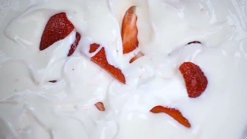 Strawberry Falling in White Yogurt Cream