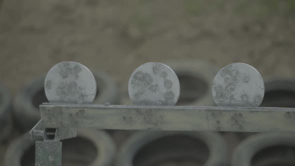 Iron Targets During the Shooting. Slow Motion.