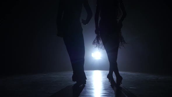 Dance Couple Demonstrating Magnificent Choreography of Latino, Black Background