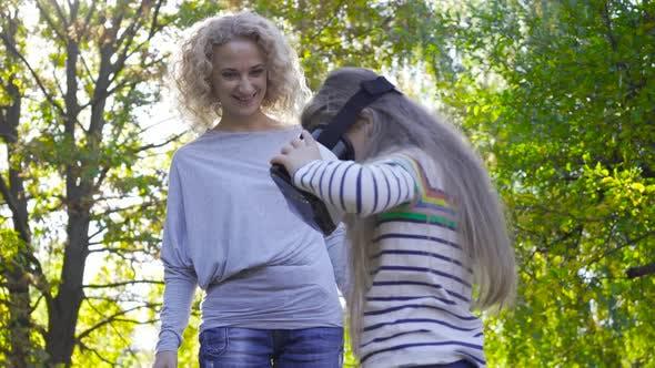 Thumbnail for Portrait of Brunette Caucasian Girl in VR Googles Dressed in Striped Blouse